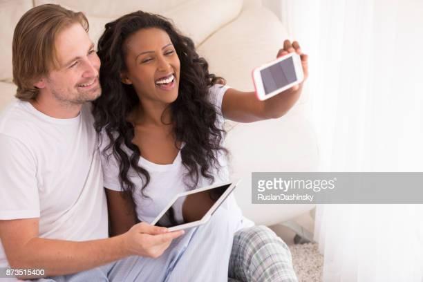 beautiful young mixed couple wearing pajama