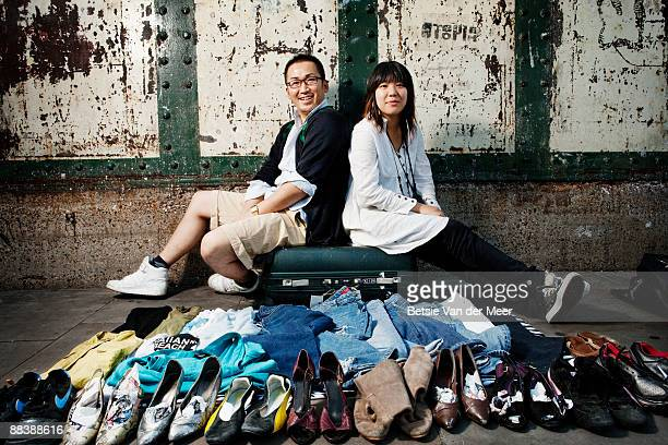 Couple selling clothes on streetmarket.