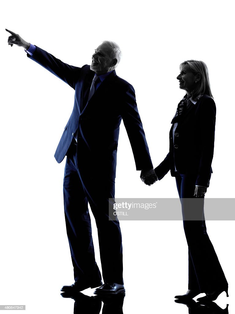couple senior pointing silhouette : Stock Photo