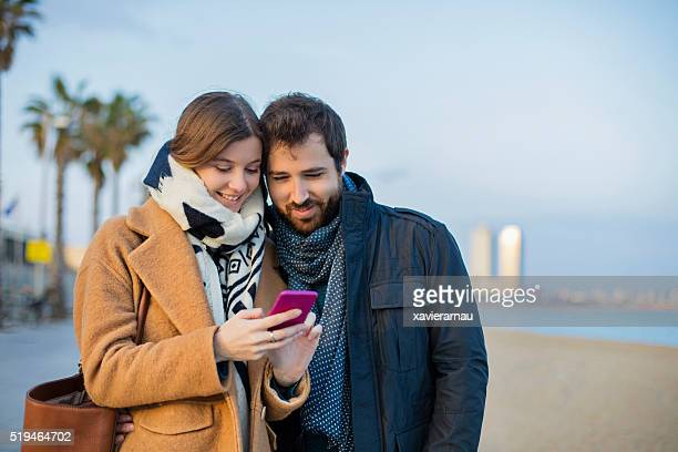 Couple sharing a message on the smart phone
