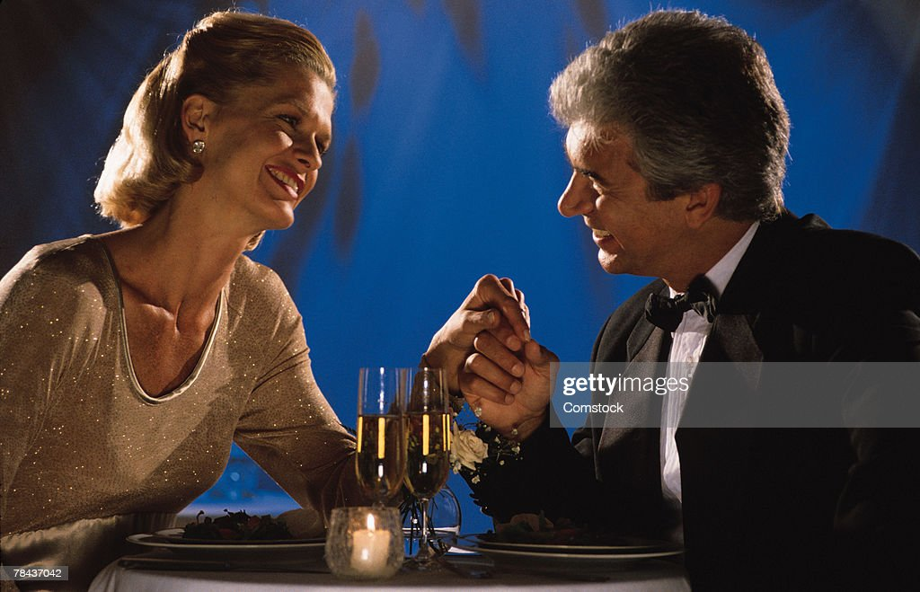 Couple sharing a romantic moment at dinner : Stockfoto