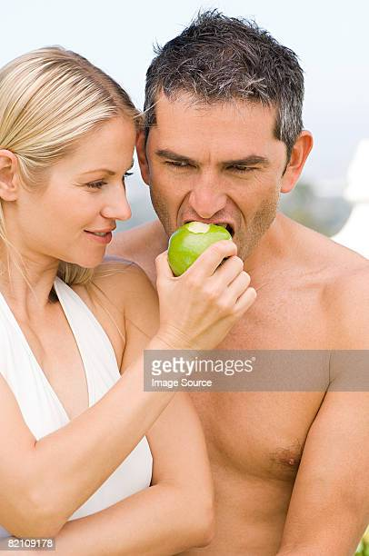 Couple sharing an apple
