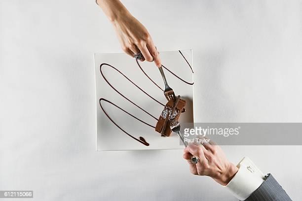 Couple sharing chocolate dessert