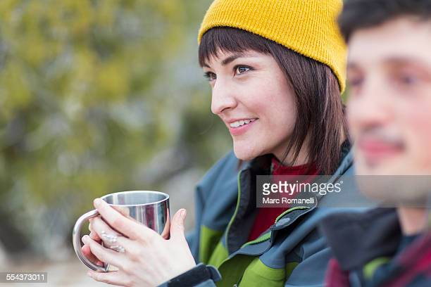 Couple sharing coffee outdoors