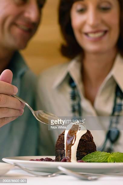 Couple sharing dessert, close-up