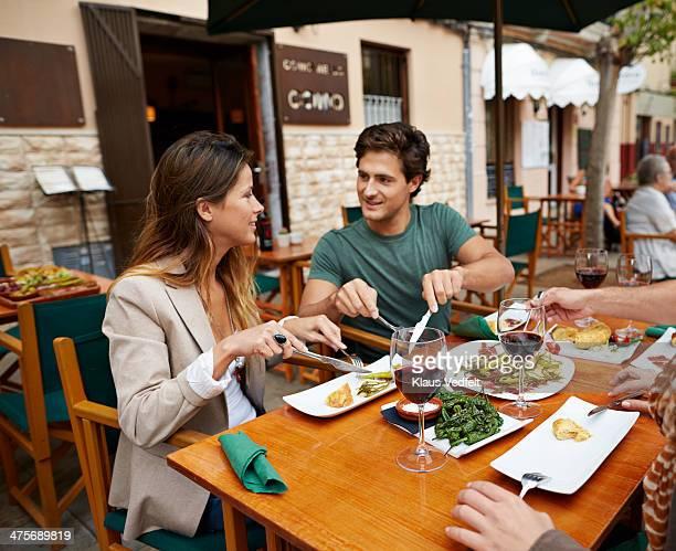 Couple sharing food at café
