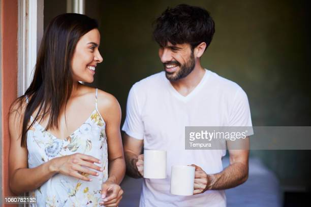 couple sharing morning coffee - hygge stock pictures, royalty-free photos & images