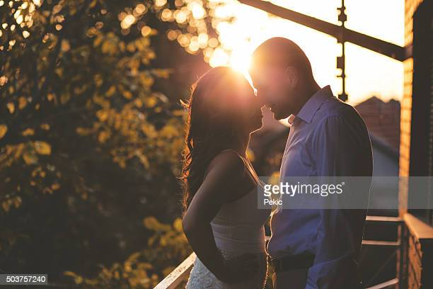 Couple sharing romantic sunset