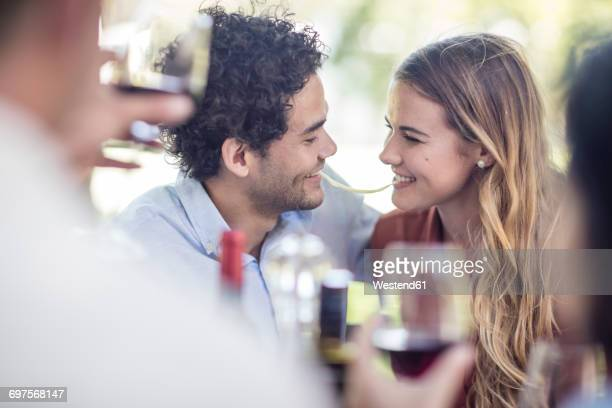 Couple sharing spaghetti at outdoor table