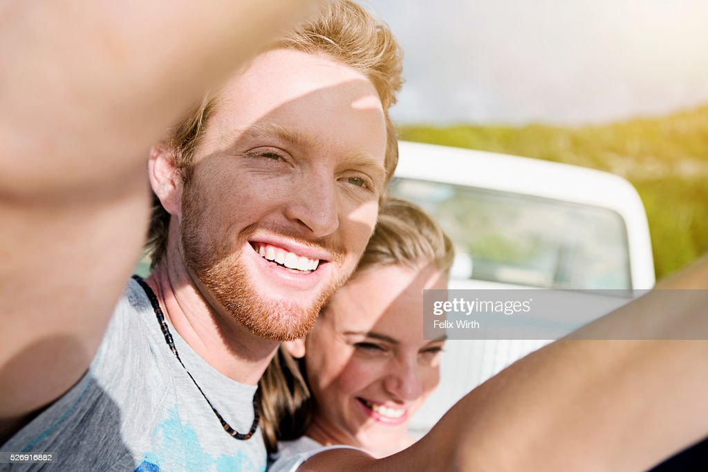 Couple shielding eyes from sunlight : Stock Photo