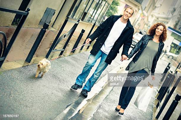 Couple shopping and walking under the rain