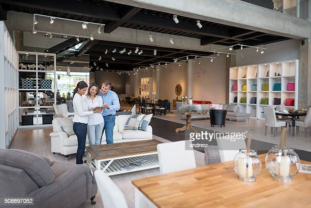 couple shopping at a furniture store - furniture stock pictures, royalty-free photos & images