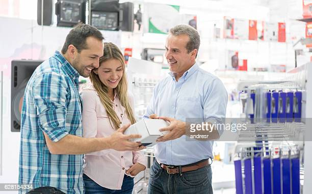 Couple shopping at a tech store