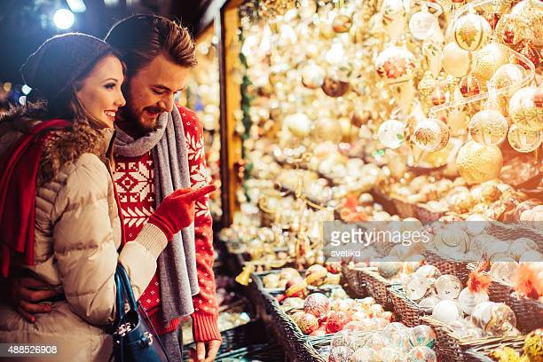 Couple shopping at christmas fair.
