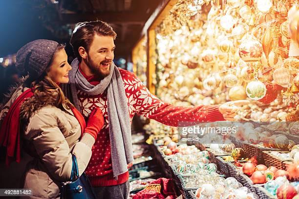 Couple shopping at christmas fair.