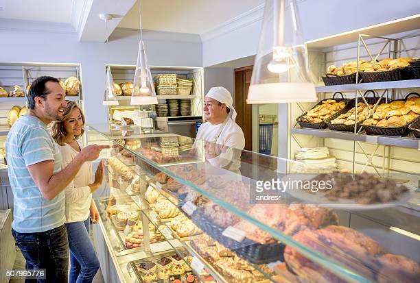 Couple shopping at the bakery or pastry shop