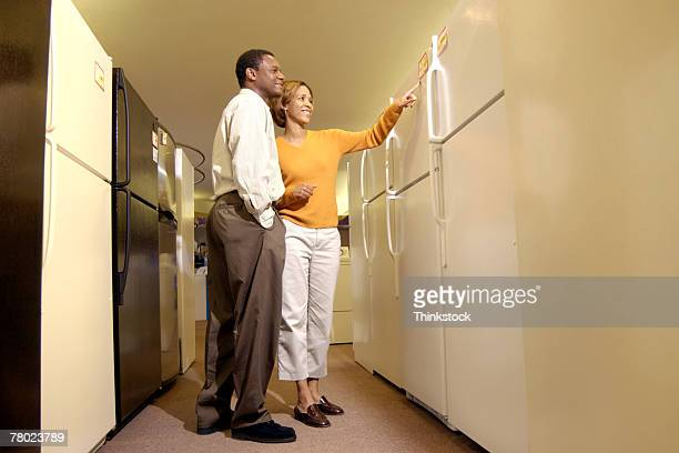 couple shopping for appliances - thinkstock foto e immagini stock