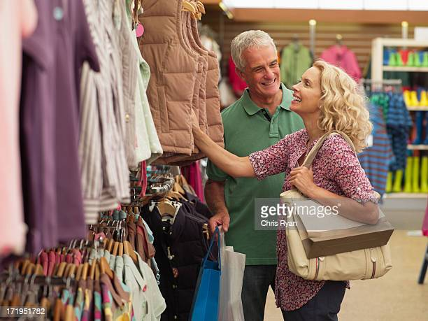 Couple shopping for clothing in store