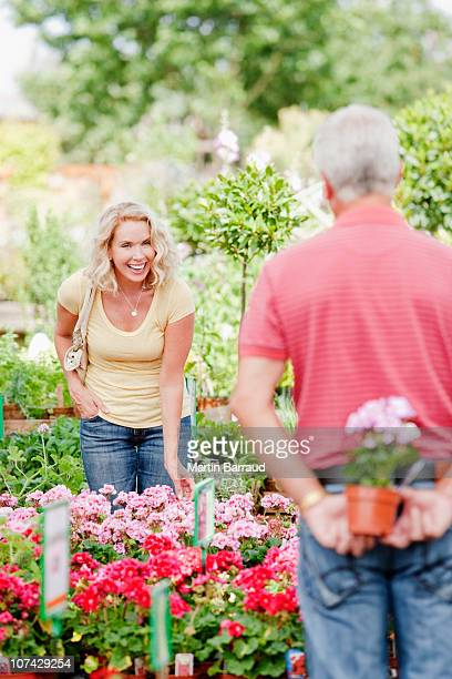 Couple shopping for flowers in nursery