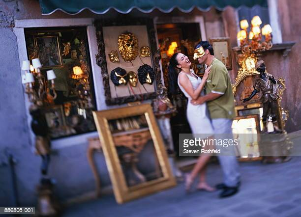 couple shopping for mask in campo santo stefano, venice, italy - campo santo stefano stock pictures, royalty-free photos & images