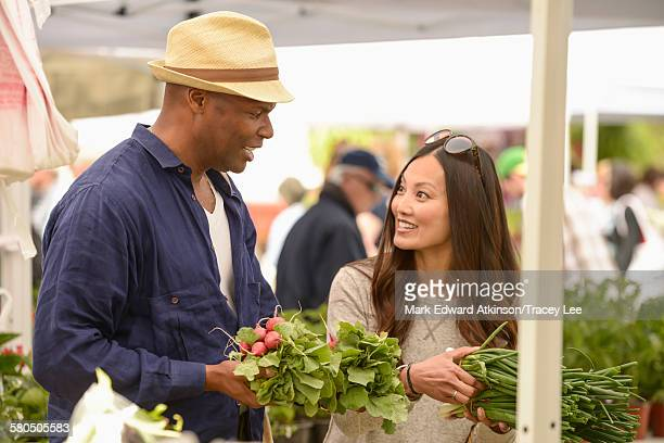 Couple shopping for produce at farmers market