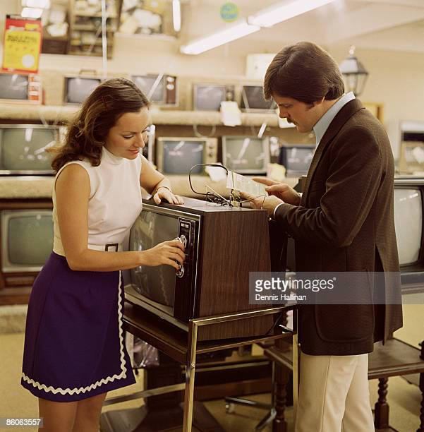 Couple shopping for television