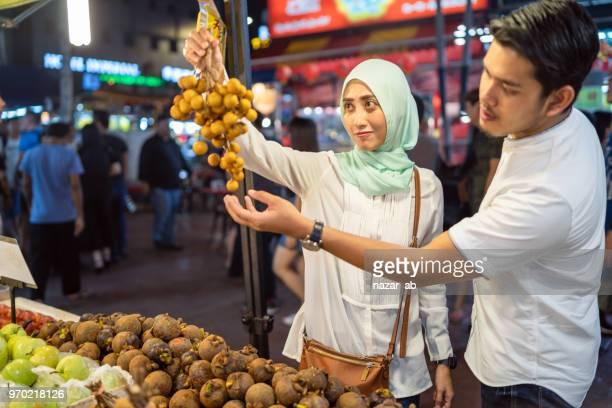 Couple shopping in Jalan Alor, Kuala Lumpur, Malaysia.