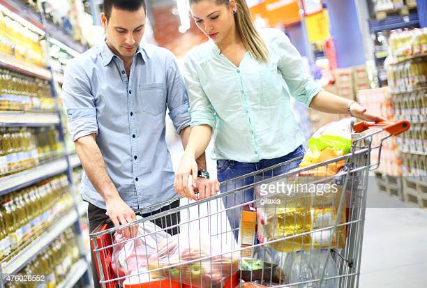 Couple shopping in local supermarket.