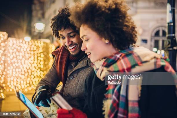 Couple shopping online for Christmas
