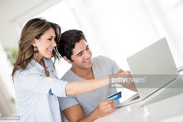 Couple shopping online from home
