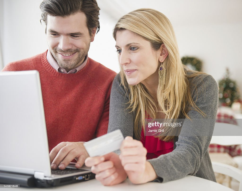 Couple shopping online together : Stock Photo