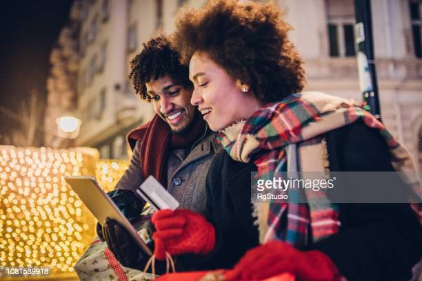 Couple shopping online with digital tablet