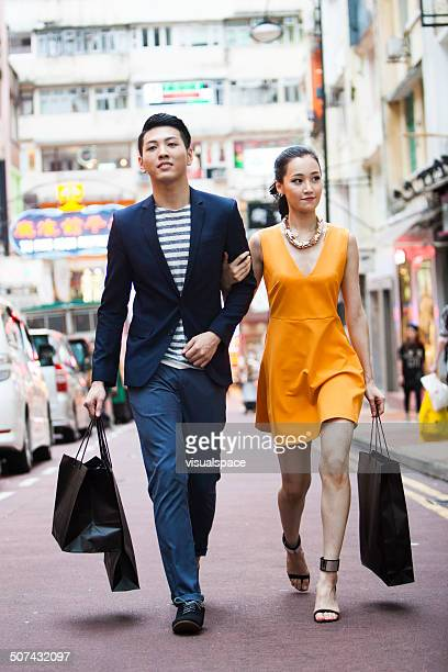 couple shopping - fashion hong kong stock photos and pictures