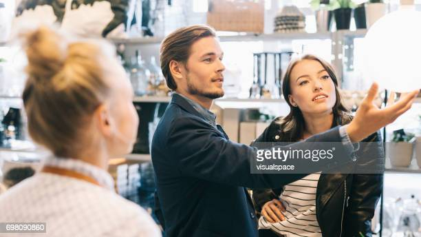 couple shopping - electric lamp stock pictures, royalty-free photos & images