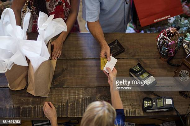 couple shopping together in store paying at counter - credit card reader stock pictures, royalty-free photos & images