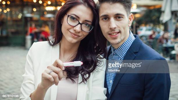Couple showing pregnancy test