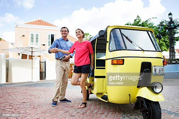 couple sightseeing from tuk tuk - auto rickshaw stock pictures, royalty-free photos & images