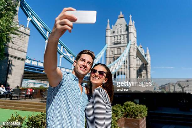 Couple sightseeing in London and taking a selfie