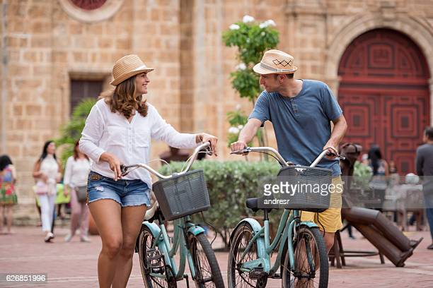Couple sightseeing on bikes in Cartagena