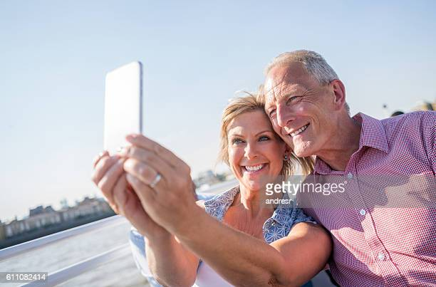 Couple sightseeing taking a selfie on a boat