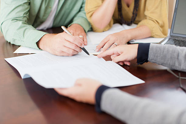Couple signing contract