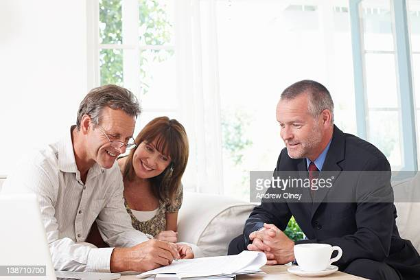 Couple signing contract with financial advisor