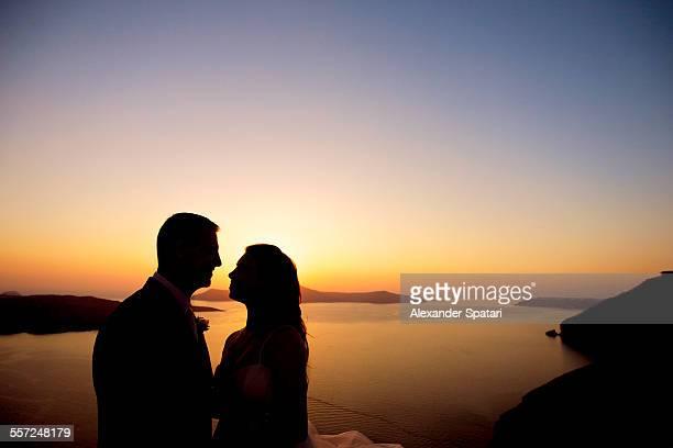 Couple silhouette at sunset in Santorini