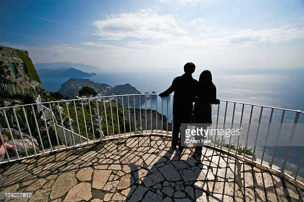 couple silhouette on balcony - nee nee stock pictures, royalty-free photos & images