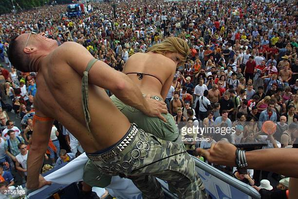 A couple simulate sexual intercourse on top of a truck blaring techno music to thousands of ravers during the annual Love Parade July 12 2003 in...