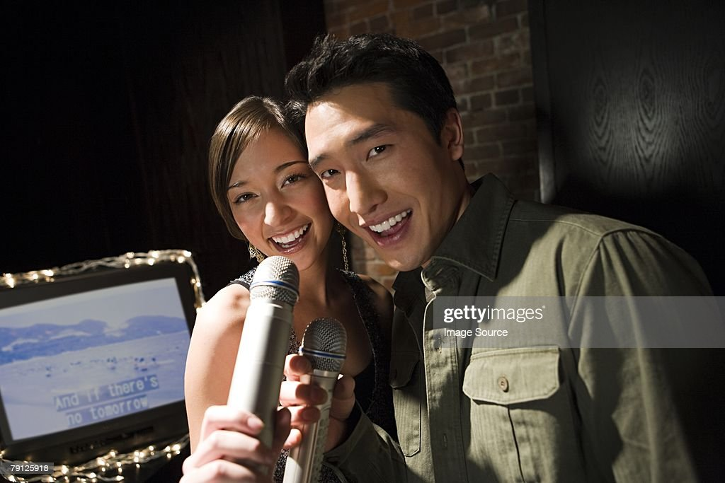 Couple singing karaoke : Stock Photo