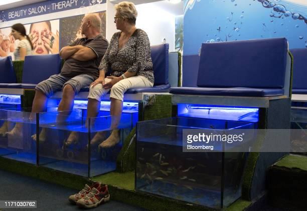 Couple sit for a fish pedicure in Hersonissos, on the island of Crete, Greece, on Tuesday, Sept. 24, 2019. Like Crete, Europes other tourist...