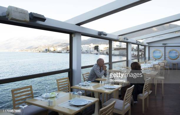 Couple sit in a Taverna in Hersonissos, on the island of Crete, Greece, on Tuesday, Sept. 24, 2019. Like Crete, Europes other tourist hot-spots are...