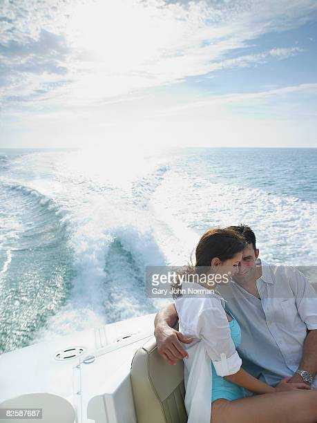 Couple sit in stern of powerboat