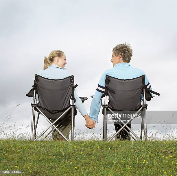 Couple Sit on Folding Chairs